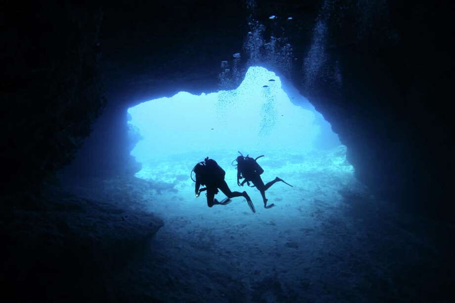 """Shark Tooth Cave in Tonga, which is the first country to manage its seabed mineral activities.<252><137>within its national marine space and under its sponsorship in international waters.""""<252><137> Photo: Scott Portelli / Getty Images/Moment RF / ONLINE_YES"""