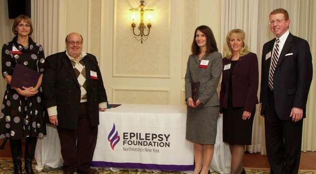 Recognized at the Epilepsy Foundation of Northeastern New York 's awards dinner were, from left: Lorraine Ferguson from Sandler Training, 5 years of service; Eugene Nachamkin from Priority Group of Companies, 10 years and immediate past president of the foundation; Alicia Riegert from Pioneer Bank, 5 years of service; Jeannine Garab, foundation executive director; and Rusty Senecal from Capital Care, current president.