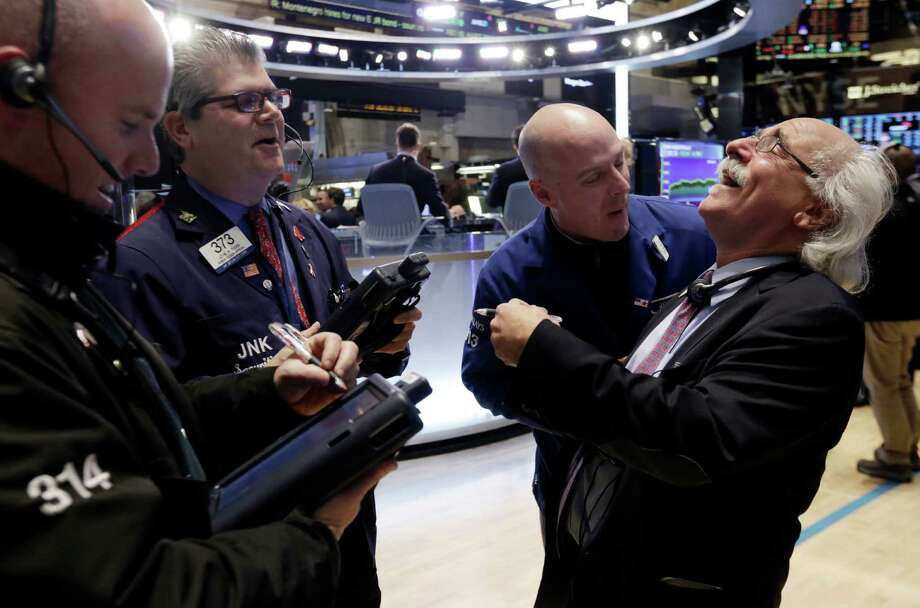 Traders laugh Thursday at the end of the trading day on the floor of the New York Stock Exchange. The stock market is bouncing back from a tough start to the year. The Dow Jones industrial average jumped 323 points, or 1.8 percent, to 17,907. Photo: Richard Drew /Associated Press / AP