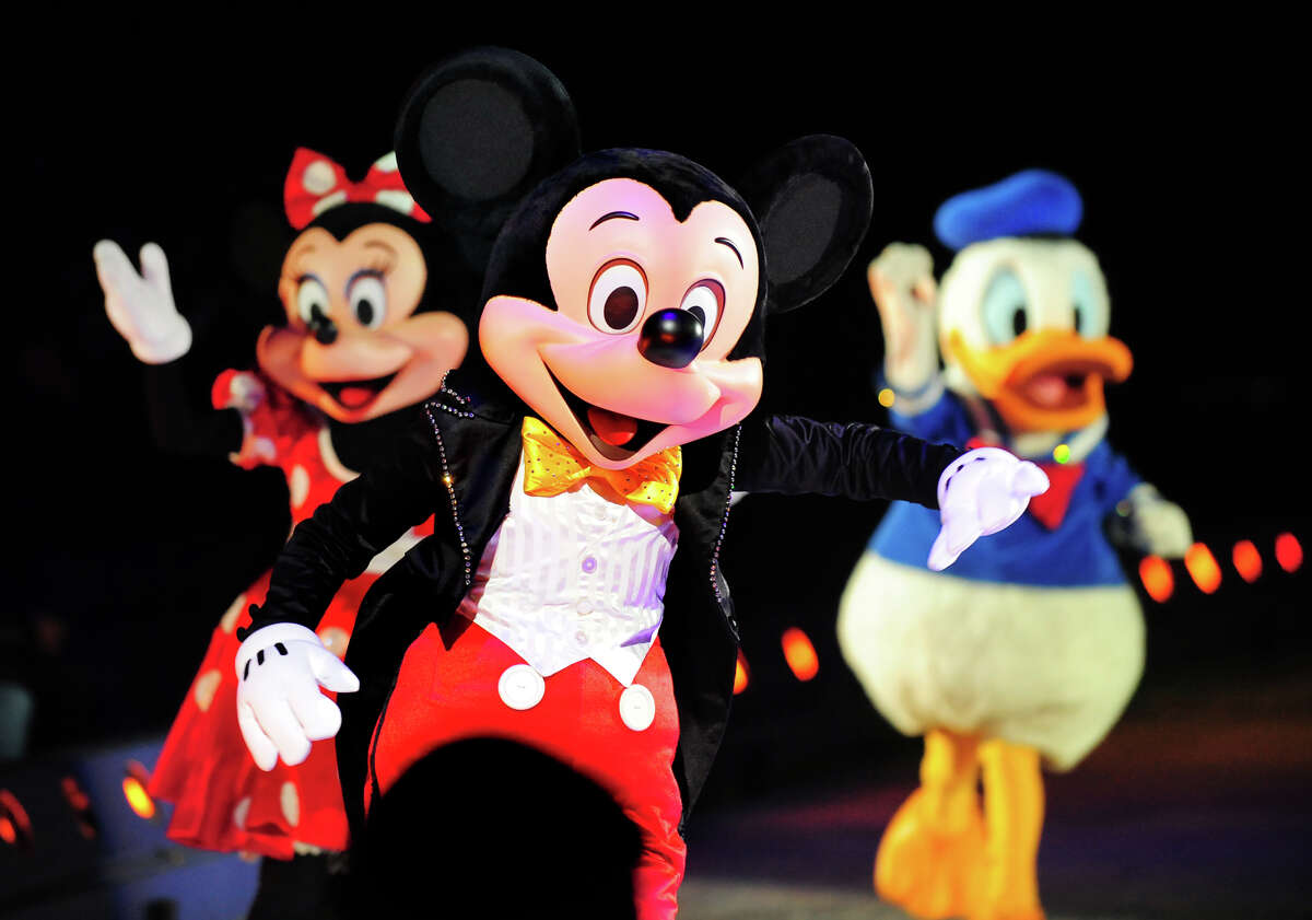 Mickey Mouse along with Minnie Mouse and Donald Duck wave to children in the audience during the opening night of Disney on Ice's production of their show