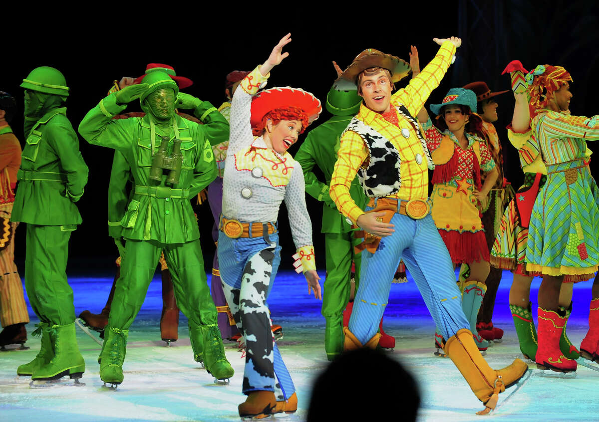 Characters from Disney's Toy Story entertain the children in the audience during the opening night of Disney on Ice's production of their show