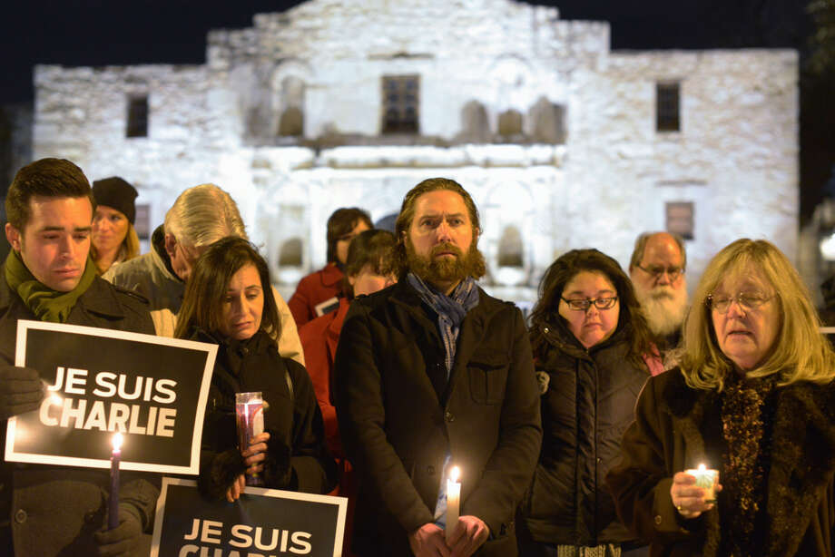 San Antonio journalists gather at The Alamo on Thursday, Jan, 8, 2015, to show solidarity with the French journalists of the Charlie Hebdo publication who were killed by Muslim extremists in Paris yesterday. Photo: Billy Calzada, San Antonio Express-News /  San Antonio Express-News