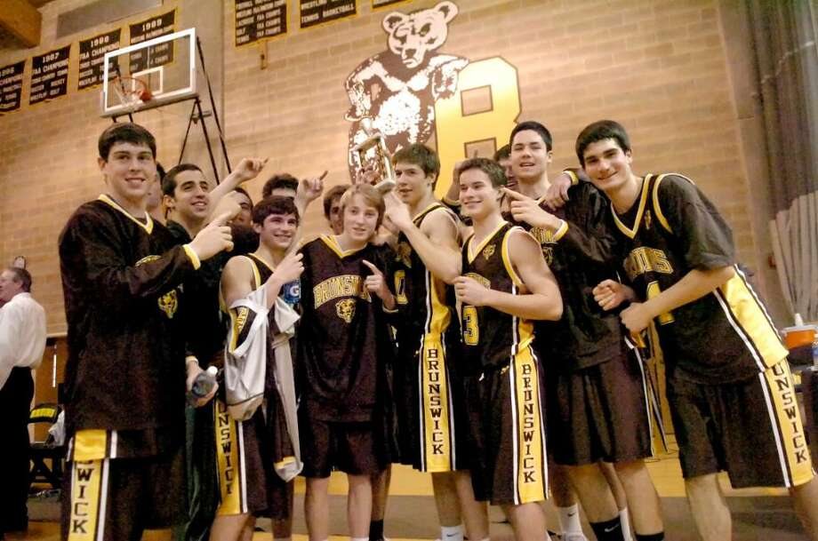 The Brunswick basketball team celebrates their FAA Championship with their victory over St. Lukes, at Brunswick, on Sunday, February 28, 2010. Photo: Helen Neafsey / Greenwich Time