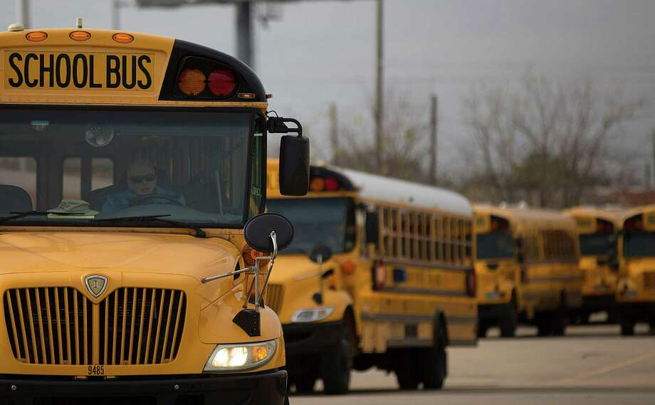A HISD bus driver leaves the district's Northwest Shop on an afternoon route. Photo: Johnny Hanson, Staff / © 2015  Houston Chronicle