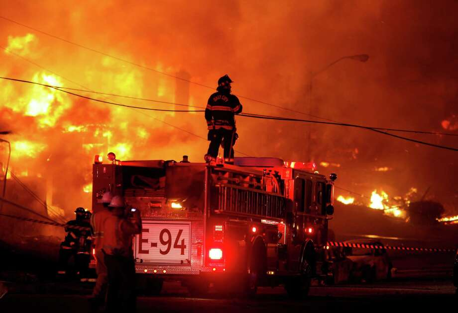 Firefighters battle a fire that destroyed a San Bruno neighborhood in September 2010. The blaze was caused by a natural gas explosion from an underground PG&E pipeline. Photo: Brant Ward / The Chronicle / ONLINE_YES
