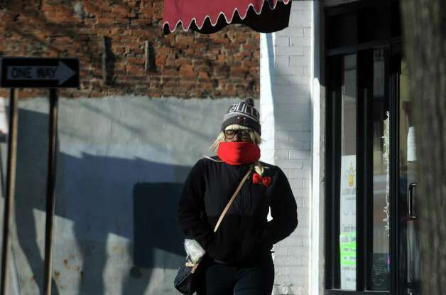 A women bundled from the cold walks down Central Avenue on Thursday Jan. 8, 2015 in Albany, N.Y. (Michael P. Farrell/Times Union) Photo: Michael P. Farrell / 00030121A