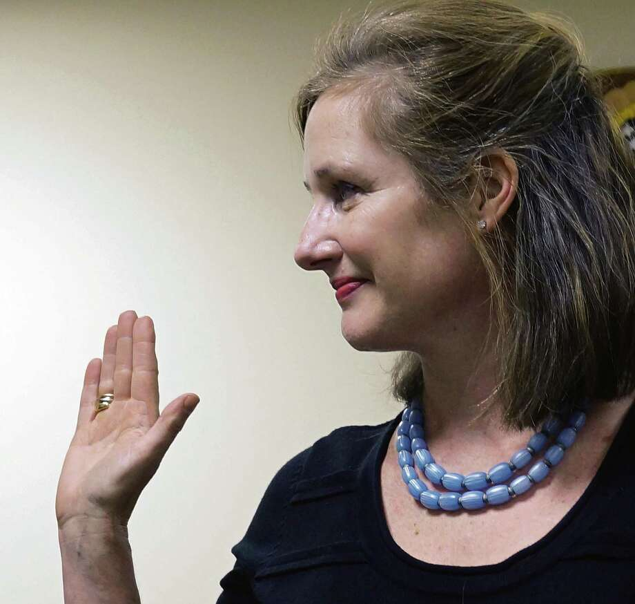 Democrat Shelia Marmion takes the oath of office for selectman Thursday. Photo: Genevieve Reilly / Fairfield Citizen