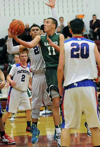 Schalmont forward Zac O'Dell, #11, goes up for a shot during a basketball game against Broadalbin-Perth on Monday, Dec. 22, 2014 in Albany, N.Y. (Lori Van Buren / Times Union) Photo: Lori Van Buren / 00029959A