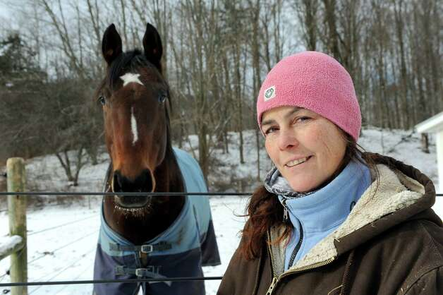 Horsewoman Valerie Buck with Comet on Wednesday, Jan. 7, 2015, at Long Shadows Farm in Cambridge, N.Y. Buck, formerly with Saratoga War Horse, has started a new equine therapy program for women who have experienced trauma called ACTT Naturally. (Cindy Schultz / Times Union) Photo: Cindy Schultz / 00030061A