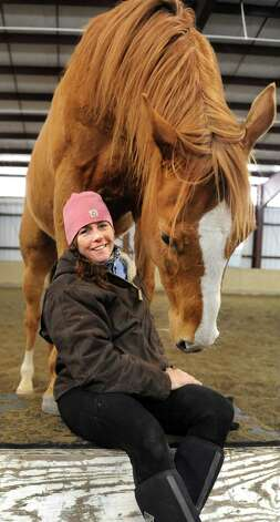 Horsewoman Valerie Buck and Budder on Wednesday, Jan. 7, 2015, at Long Shadows Farm in Cambridge, N.Y. Buck, formerly with Saratoga War Horse, has started a new equine therapy program for women who have experienced trauma called ACTT Naturally. (Cindy Schultz / Times Union) Photo: Cindy Schultz / 00030061A