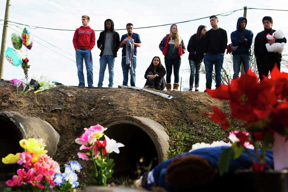 Friends and classmates from Manvel High School gather Thursday at the site where Sara Silvas, Josh Rodriguez and Zori Petrova died Wednesday afternoon in a fiery crash on a narrow Brazoria County road. Photo: Marie D. De Jesus, Staff / © 2015 Houston Chronicle