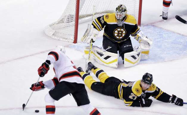 Boston Bruins defenseman Dougie Hamilton (27) drops to the ice to prevent a shot on goalie Niklas Svedberg by New Jersey Devils defenseman Marek Zidlicky (2) during the third period of an NHL hockey game in Boston, Thursday, Jan. 8, 2015. The Bruins shut out the Devils, 3-0. (AP Photo/Charles Krupa) ORG XMIT: MACK115 Photo: Charles Krupa / AP