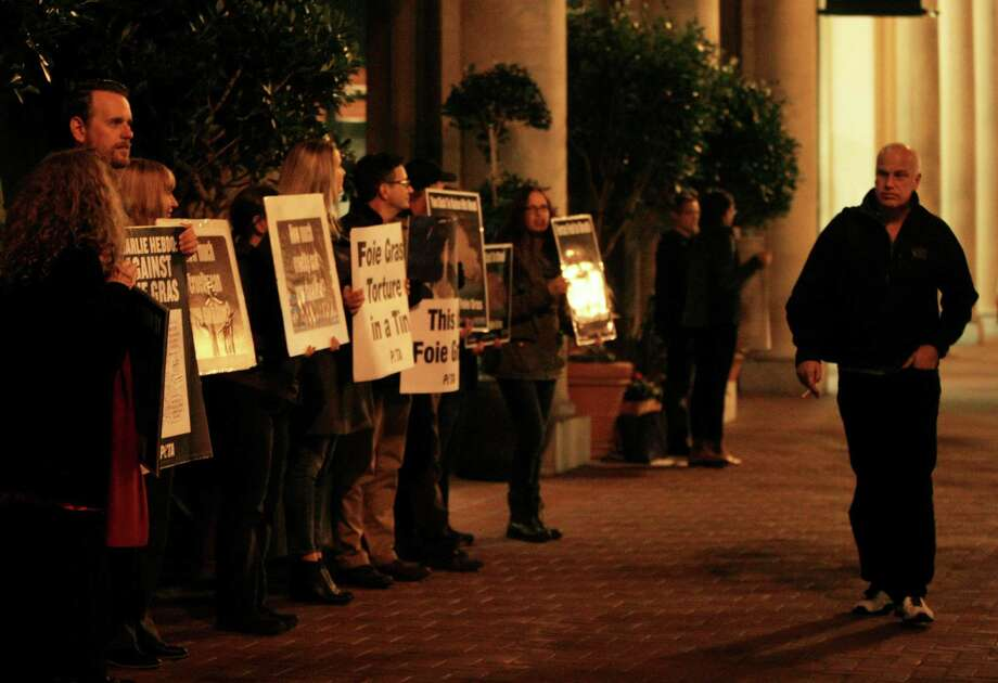 PETA activists line up and hold signs during a protest against the overturned California ban of foie gras outside of One Market Restaurant in San Francisco on Thursday. Photo: Jessica Christian / SF Weekly / ONLINE_YES