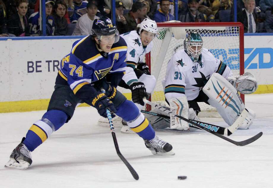 As Brenden Dillon moves in, the Blues' T.J. Oshie looks to shoot as San Jose goalie Antti Niemi holds his ground. Niemi was pulled in the second period after allowing five goals on 21 shots. Photo: Tom Gannam / Associated Press / FR45452 AP