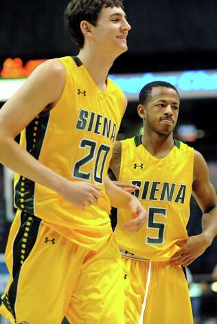 Siena's Jimmy Merrill, left, and Evan Hymes enjoy their 79-69 win over Niagara after their basketball game on Thursday, Jan. 8, 2015, at Times Union Center in Albany, N.Y. (Cindy Schultz / Times Union) Photo: Cindy Schultz / 00030029B