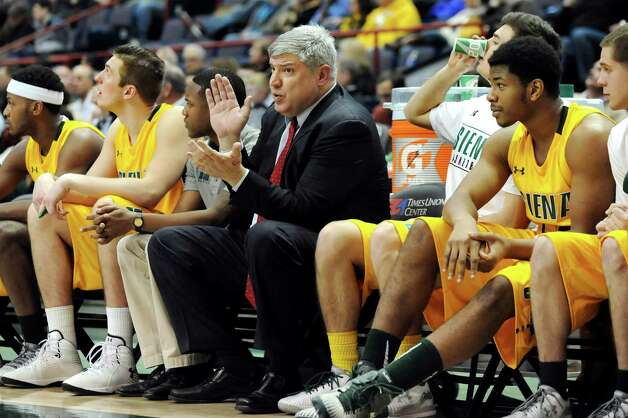 Siena's coach Jimmy Patsos, center, sits with his team during their basketball game against Niagara on Thursday, Jan. 8, 2015, at Times Union Center in Albany, N.Y. (Cindy Schultz / Times Union) Photo: Cindy Schultz / 00030029B
