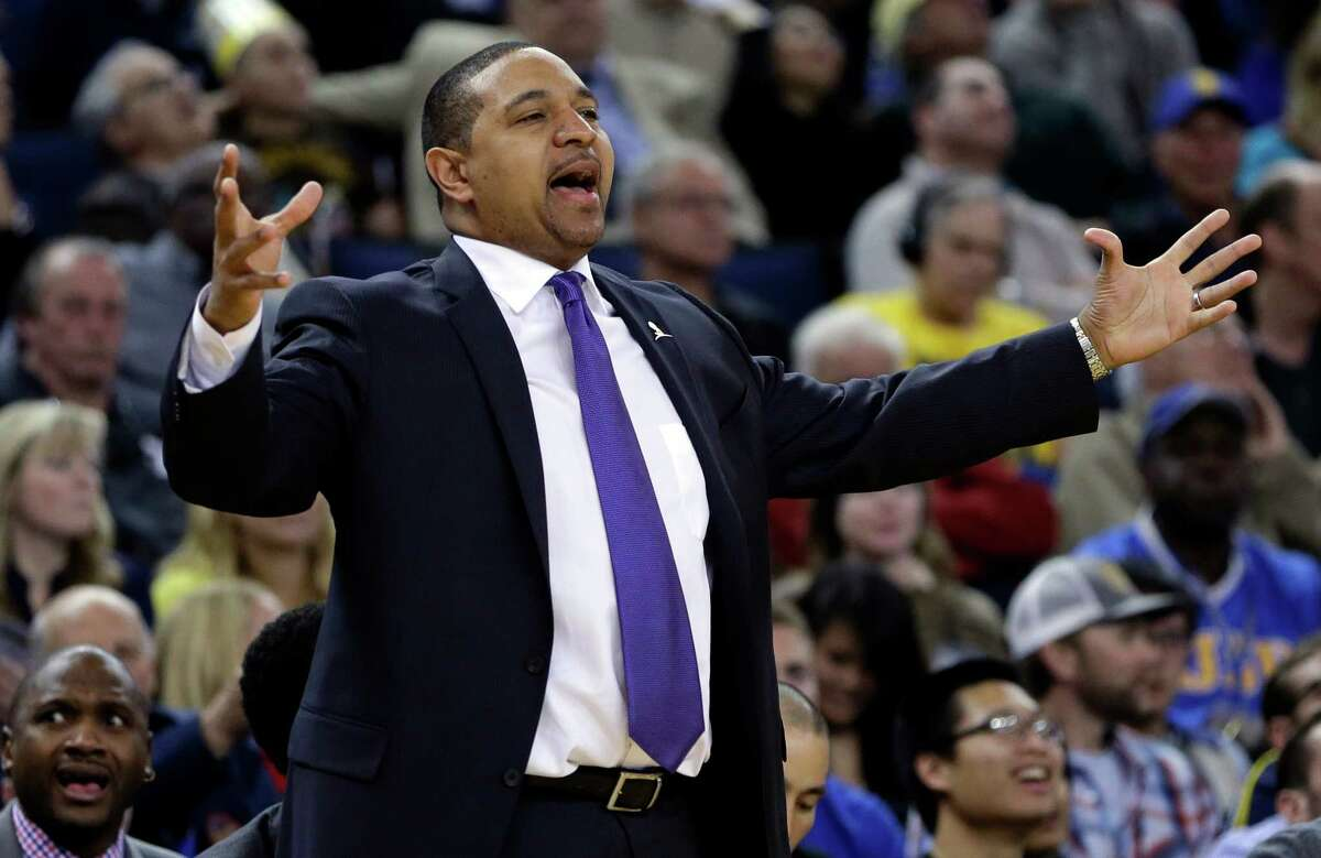 FILE - In this Friday, March 7, 2014, file photo, Golden State Warriors coach Mark Jackson gestures from the sideline during the second half of an NBA basketball game against the Atlanta Hawks in Oakland, Calif. There will be a lot of eyes looking at the man sitting courtside when the Warriors host the Cleveland Cavaliers on Friday, Jan. 9, 2015, at Oracle Arena. Jackson will return to the building for the first time since the Warriors fired him as coach after last season. Jackson will be part of ESPN's national telecast. (AP Photo/Ben Margot, File)