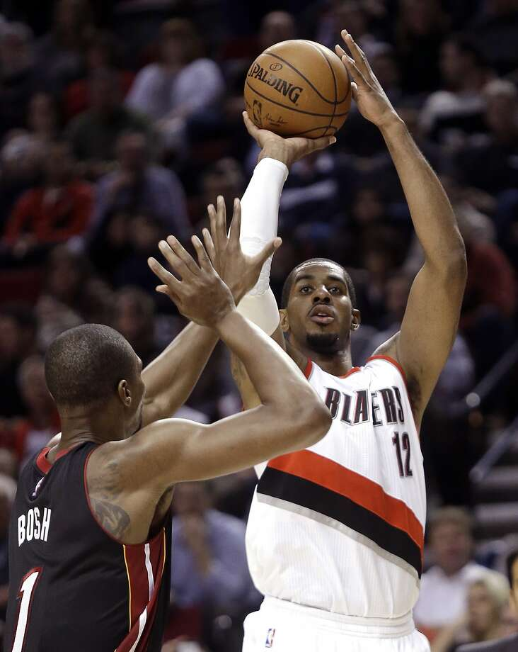 Portland Trail Blazers forward LaMarcus Aldridge, right, shoots over Miami Heat center Chris Bosh during the second half of an NBA basketball game in Portland, Ore., Thursday, Jan. 8, 2015. Aldridge led the Trail Blazers with 24 points and pulled in 12 rebounds as the Blazers defeate the Heat 99-83. (AP Photo/Don Ryan) Photo: Don Ryan, Associated Press