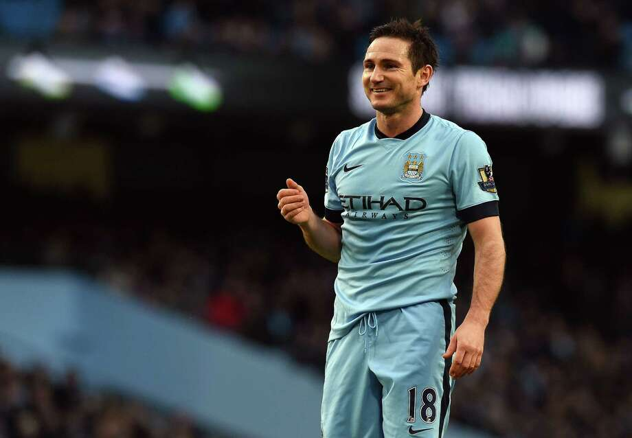 Manchester City's English midfielder Frank Lampard smiles during the English FA Cup third round football match between Manchester City and Sheffield Wednesday at The Etihad Stadium in Manchester, north west England on January 4, 2015. AFP PHOTO / PAUL ELLIS  RESTRICTED TO EDITORIAL USE. No use with unauthorized audio, video, data, fixture lists, club/league logos or live services. Online in-match use limited to 45 images, no video emulation. No use in betting, games or single club/league/player publications.PAUL ELLIS/AFP/Getty Images Photo: PAUL ELLIS / AFP/Getty Images / AFP