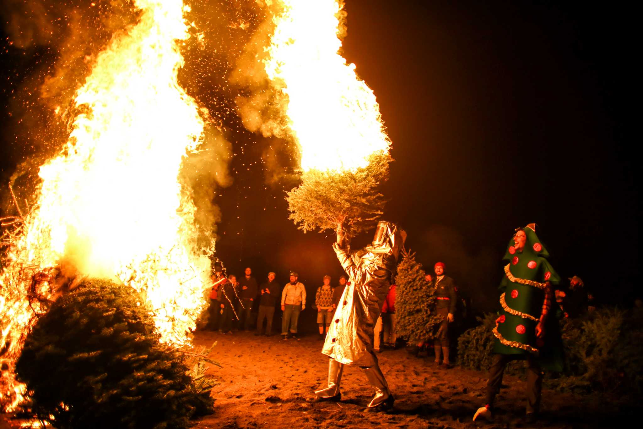 Oklahoma City Sales Tax >> Christmas trees set ablaze in annual tradition - seattlepi.com