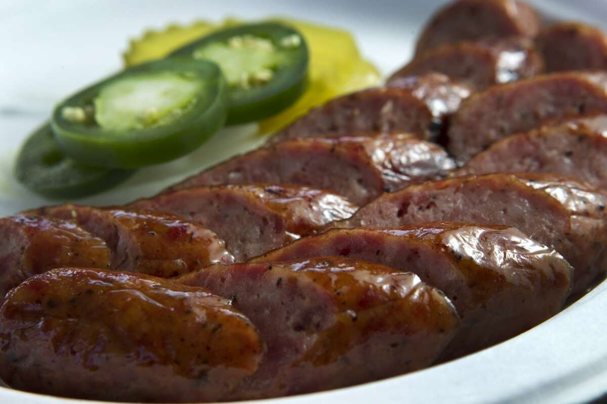 Sausage and jalapeños are shown at Corkscrew BBQ. (Photo: Brett Coomer / Houston Chronicle )