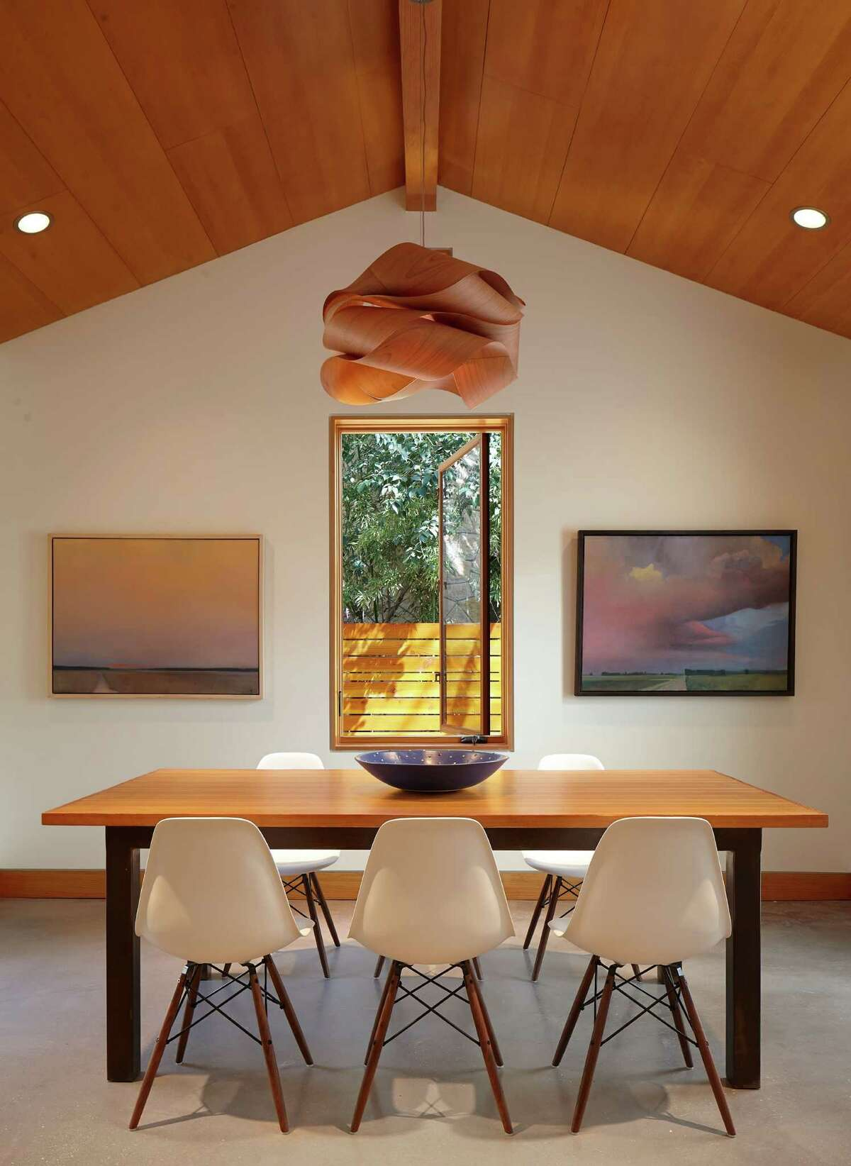 A light fixture made from a giant shaving of cherry veneer and bought at Nest complements fir ceilings in the home of Craig and Molly McMahon. The McMahons opened up the concrete home that was built in 1953 and gave it a modern minimalist aesthetic.