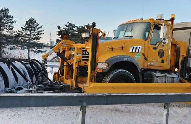 A state Department of Transportation snowplow enters I-90 at Fuller Road Friday morning, Jan. 9, 2015, in Albany, NY.  (John Carl D'Annibale / Times Union) Photo: John Carl D'Annibale / 00030144A