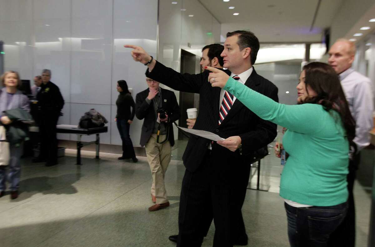 Sen. Ted Cruz is instructed which jury room to report to while making his way to jury duty at the Harris County Jury Summons on Friday, Jan. 9, 2015, in Houston.