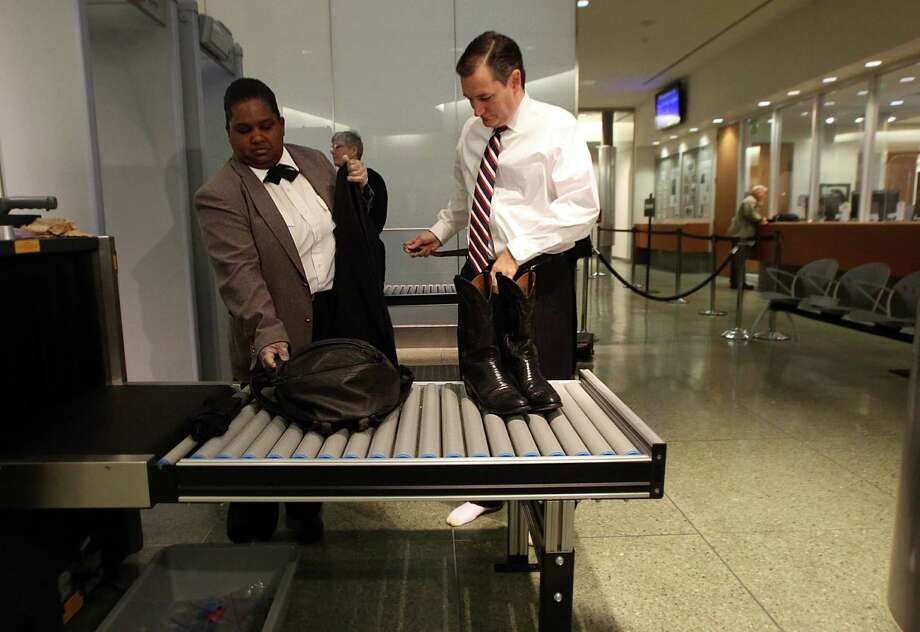 Sen. Ted Cruz goes through security while making his way to jury duty at the Harris County Jury Summons on Friday, Jan. 9, 2015, in Houston. Photo: Mayra Beltran, Houston Chronicle / © 2015 Houston Chronicle