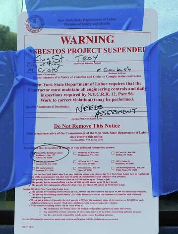 A cease-and-desist notice is taped to construction equipment at the demolition site on King Street in Troy where buildings 4, 6, 8 and 10 were torn down Aug. 14, 2013. (Lori Van Buren / Times Union archive) Photo: Lori Van Buren / 00023518A