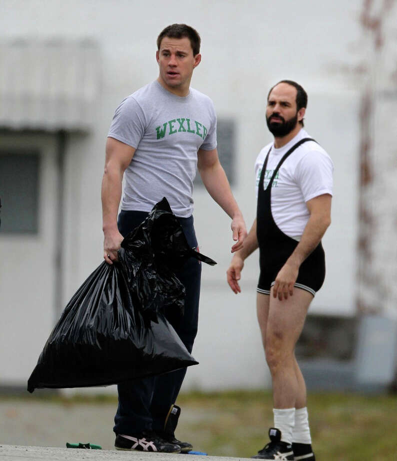 """Channing Tatum and Mark Ruffalo portray brothers on the 1988 U.S. Olympics wrestling team in the new movie, """"Foxcatcher."""" Photo: Contributed Photo / Westport News"""