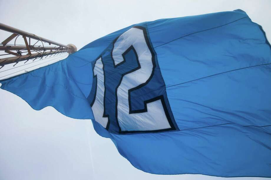"The ""12"" flag picks up wind and flies majestically on top of the Space Needle in celebration of the Seahawks playoff game set for Saturday, January 10, 2015. Photo: ANNA ERICKSON, SEATTLEPI.COM / SEATTLEPI.COM"