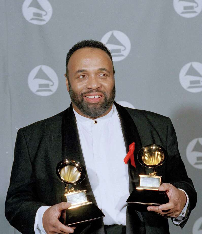 Andrae Crouch displays two Grammys he was awarded at the 37th annual Grammy Awards in 1995. His career spanned more than 50 years. Photo: Kevork Djansezian / Associated Press / AP