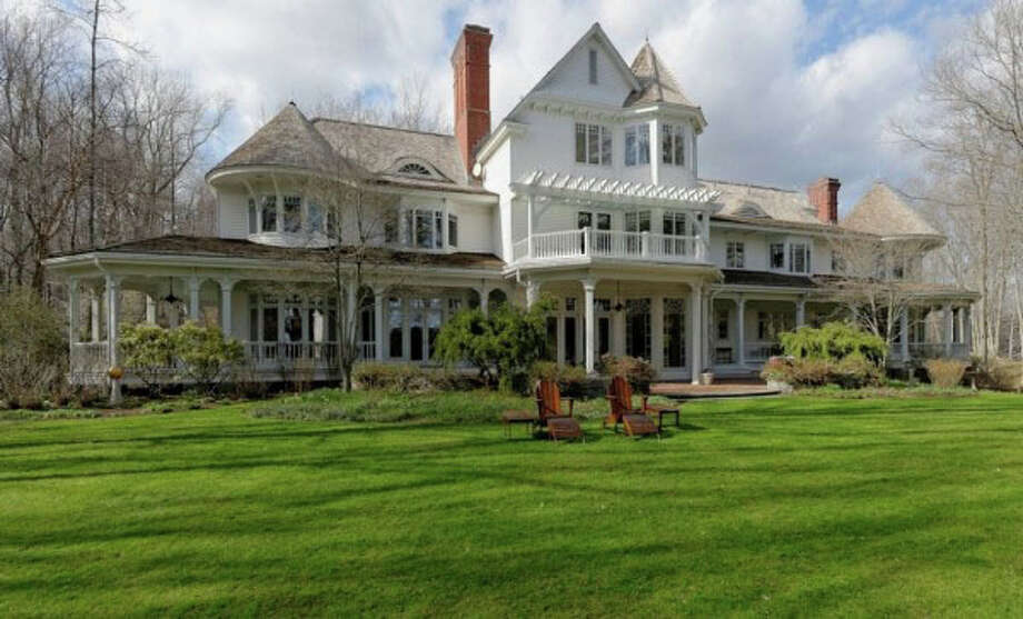 Ron and Cheryl Howard's 17,200 square-foot home in Conyers Farm reportedly sold for $27.5 million, going to a web mogul and his wife, who is a Victoria's Secret model. Photo: File / Greenwich Time Freelance