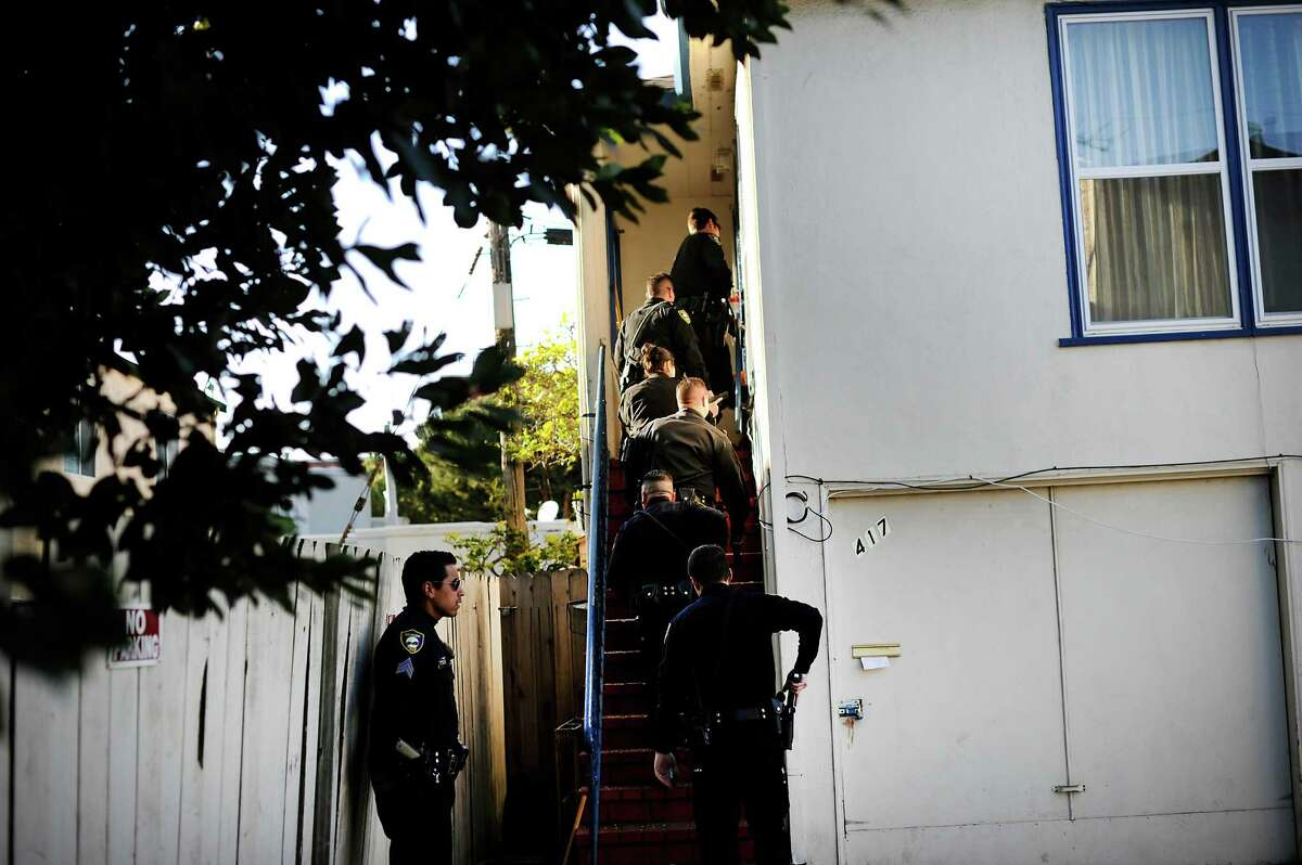 Richmond officers enter a home where a burglary in progress was reported. Richmond has seen a precipitous drop in homicides in the past few years, to a low of 11 in 2014. Police have worked hard on stopping violence between two particular groups.
