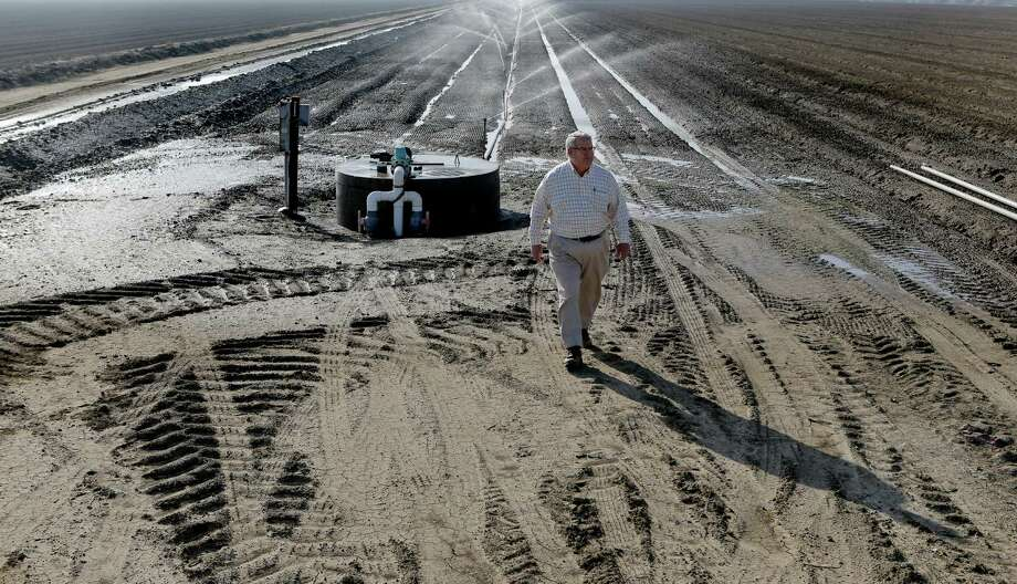 Farmer John Diener walks near one the cisterns on 640 acres of his agricultural land that uses a drainage management system. Photo: Michael Macor / The Chronicle / ONLINE_YES