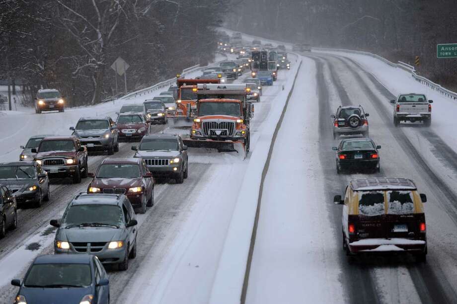 Route 8 southbound was backed up at exit 17 in Derby, Conn. Friday, Jan. 9, 2015, as an early morning snowstorm wreaked havoc on roadways. Photo: Autumn Driscoll / Connecticut Post