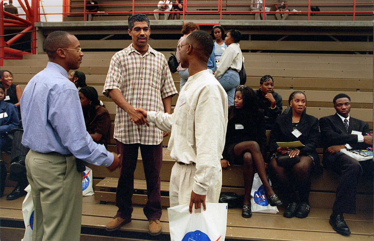 In 1998, Gabriel Donnell (center), an engineer at Intel and a member of the National Society of Black Engineers, talked to students at Santa Clara University about his work.