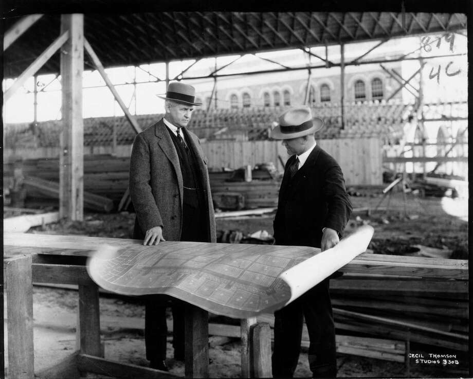 """Jesse H. Jones and architect  Alfred C. Finn at Sam Houston Hall construction site, 1928. It was at Sam Houston Hall where the city hosted that year's Democratic National Convention. But as delegates gathered here from across the country, the city was rocked by the lynching of Robert Powell. Jones publicly condemned the act, saying, """"The lynching is a blot on the good name of Texas that must be lived down."""" Photo: Cecil Thomson Studios, File  / handout"""