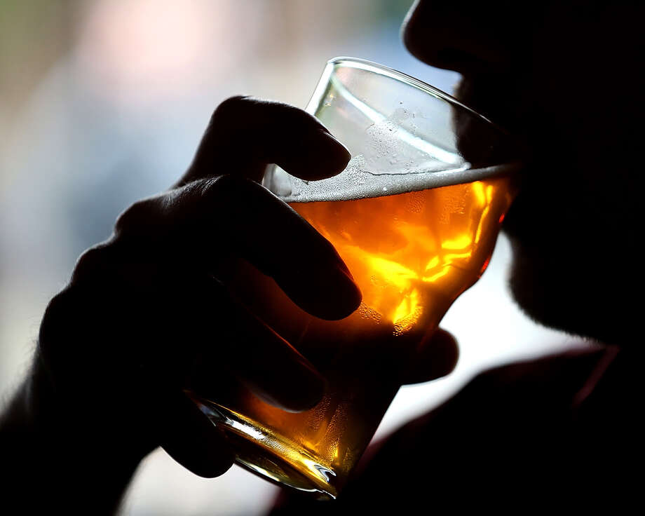 A Russian River Brewing Company customer takes a sip of the newly released Pliny the Younger triple IPA beer on February 7, 2014 in Santa Rosa, California. Photo: Justin Sullivan, Justin Sullivan/Getty Images / 2014 Getty ImagesJustin Sullivan/Getty Images