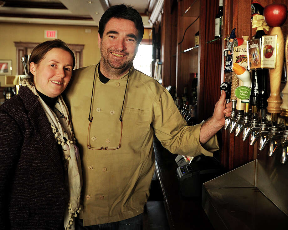 Lisa Doherty and husband Patrick Hogan, of Milford, serve forty beers on tap at The Crafty Monk at 3001 Fairfield Avenue in the Black Rock section of Bridgeport, Conn. on Thursday, January 8, 2015. Photo: Brian A. Pounds / Connecticut Post