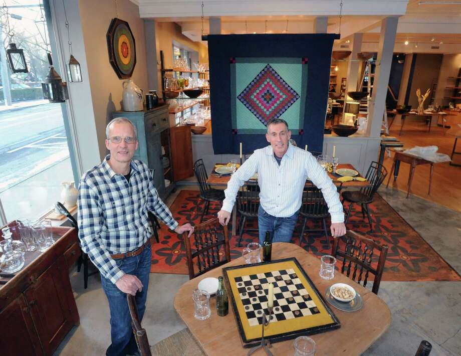 Charles Haver, left, and Stewart Skolnick, right, of Haver & Skolnick Architects of Roxbury, stand in the middle of their installation of the S. Pearce Tavern, an authentic Irish pub they created at the Simon Pearce store at 125 E. Putnam Ave., Greenwich, Conn., Friday, Jan. 9, 2015. The reception for the unveiling of the pub will take place Thursday, Jan. 15, at 6 p.m., at Simon Pearce. Photo: Bob Luckey / Greenwich Time