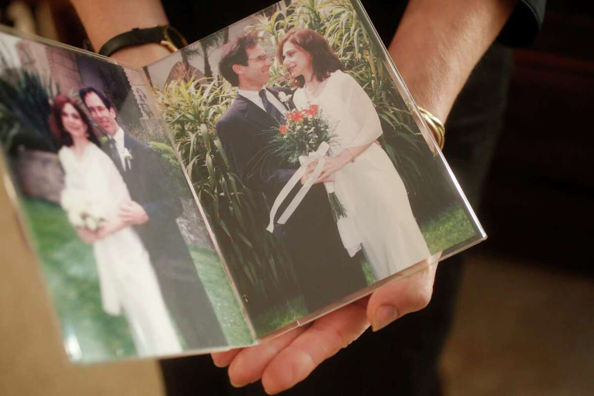 Photographs show Susan Futterman with her late husband on their wedding day in 1998. In June 2012, Futterman's husband committed suicide after she had spent weeks trying to get emergency mental health care services for him from Kaiser to no avail. She is now the named plaintiff in a union-backed lawsuit filed against Kaiser in 2013 over mental health access.