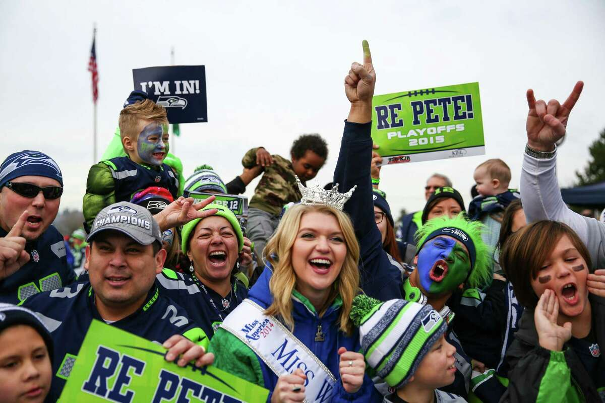 Fans cheer during a Seattle Seahawks fan rally at Renton City Hall on Friday, January 9, 2015. Hundreds of Seahawks fans came to the rally to show support for the Hawks before their playoff matchup with the Carolina Panthers.