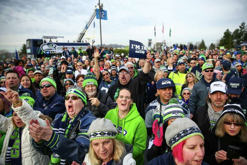 People gather during a Seattle Seahawks fan rally at Renton City Hall on Friday, January 9, 2015. Hundreds of Seahawks fans came to the rally to show support for the Hawks before their playoff matchup with the Carolina Panthers.