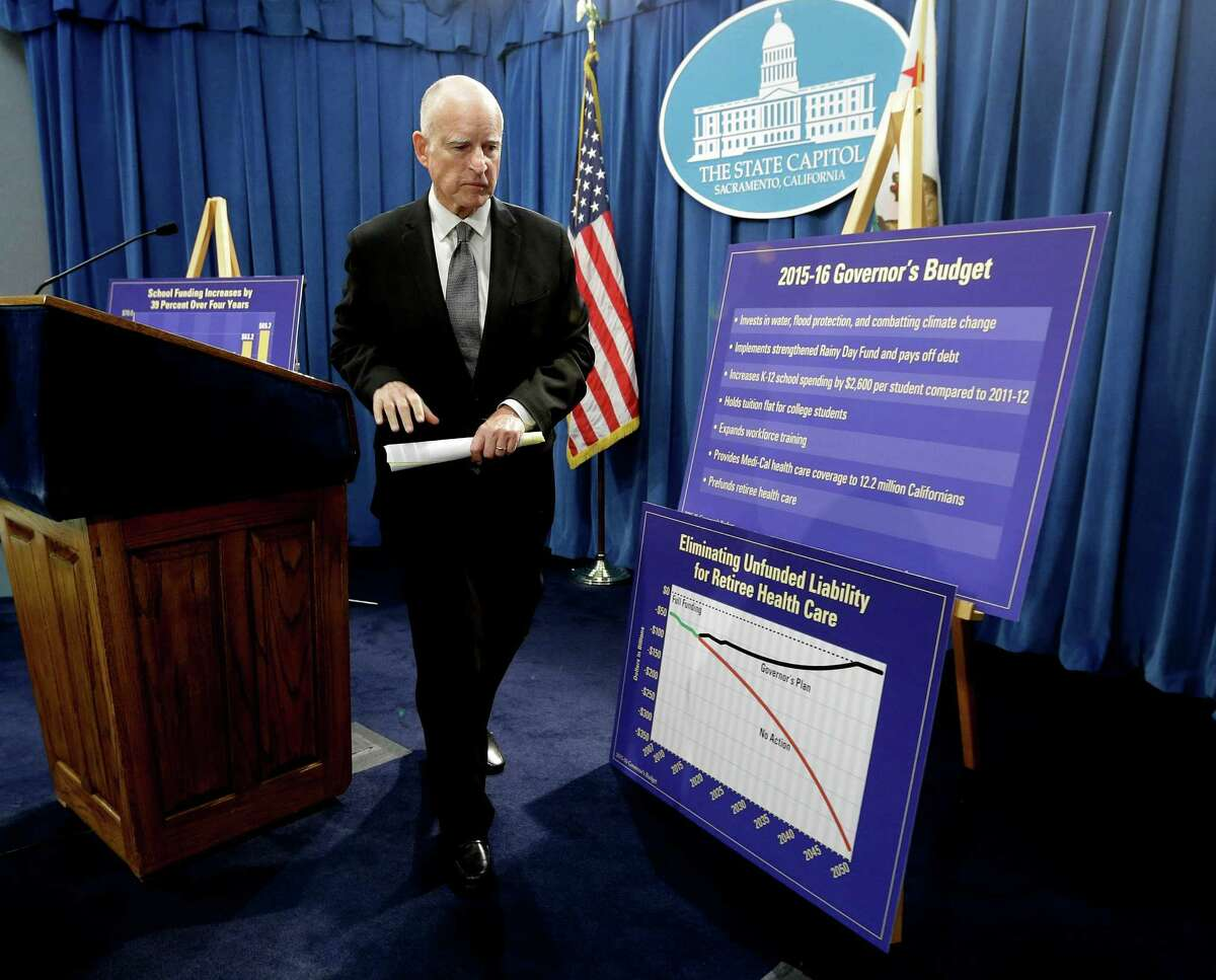 Gov. Jerry Brown leaves a news conference after unveiling his proposed 2015-16 state budget plan at the Capitol in Sacramento on Friday.