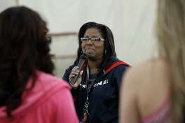 """Houston Texans cheerleading coach Alto Gary speaks to women during Cheerba, a fitness workout created by Gary at the Houston Texans Methodist Training Center (aka """"The Bubble), Thursday, Jan. 8, 2015, in Houston. Cheerba is a 50-minute workout/dance class with pompoms, similar to Zumba on Thursday nights, until mid-February. ItâÄôs for women over 17 and costs $10."""