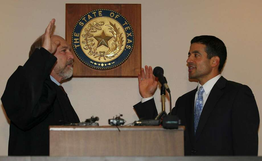 A reader criticizes recent columns on newly elected District Attorney Nico LaHood, shown with 226th District Court Judge Sid Harle as he takes the oath of office. Photo: Kin Man Hui /San Antonio Express-News / ©2014 San Antonio Express-News