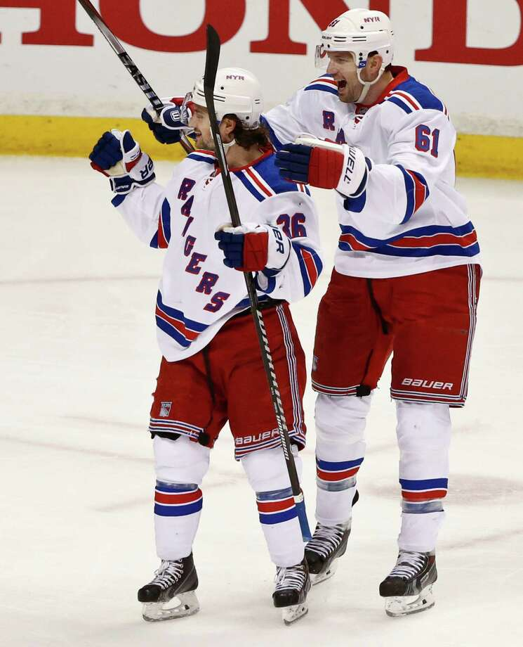 Mats Zuccarello (left), Rick Nash and the Rangers are dominating the West like no East team since '98. Photo: Lenny Ignelzi / Associated Press / AP