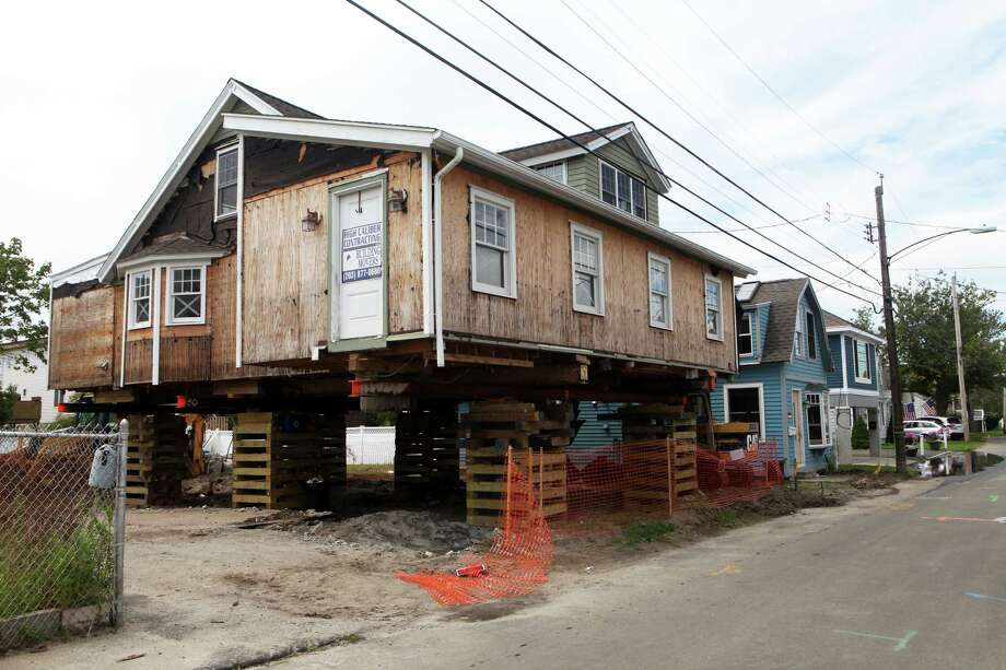 A Cooper St home in the Silver Sands neighborhood in Milford, Conn. was damaged during Hurricane Sandy in 2012. Photo: BK Angeletti, B.K. Angeletti / Connecticut Post freelance B.K. Angeletti